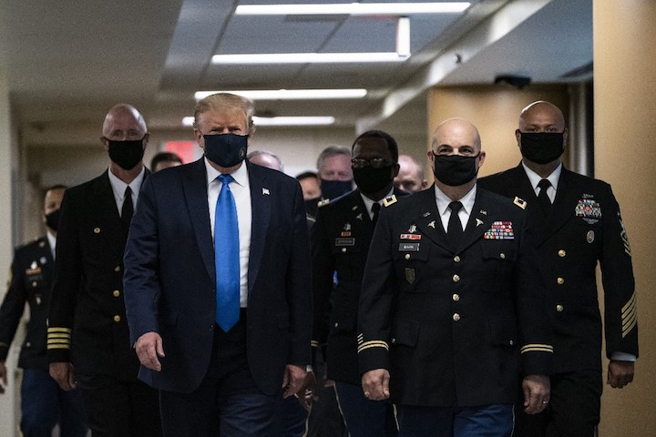 As virus rages in US, Trump finally wears a mask - Rappler