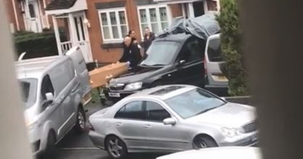 'Oh my God': Neighbour's reaction as coffin is removed from home as man arrested - Manchester Evening News