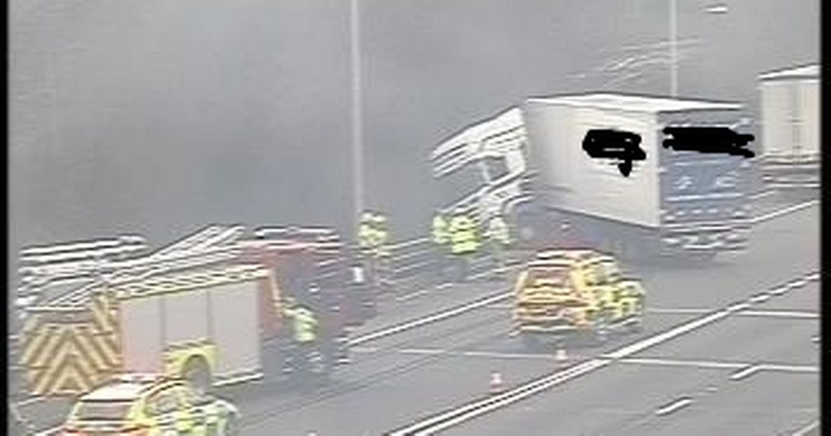 M56 closed eastbound as lorry crashes through barrier and hangs over bridge - live updates - Manchester Evening News