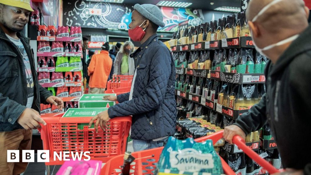 Coronavirus: South Africans cheer as alcohol goes back on sale - BBC News