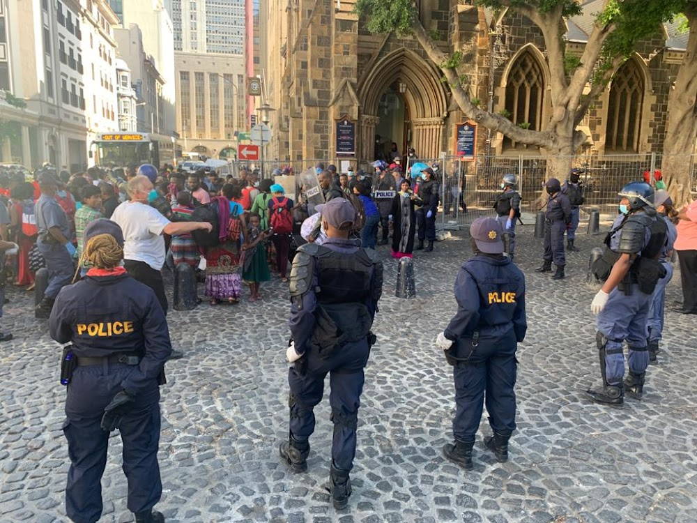 WATCH | Armed police storm Cape Town church to remove refugees - SowetanLIVE