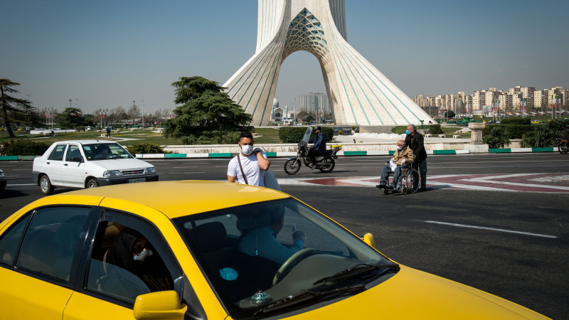 Virus toll in Iran climbs while Tehran remains open for business - Sydney Morning Herald