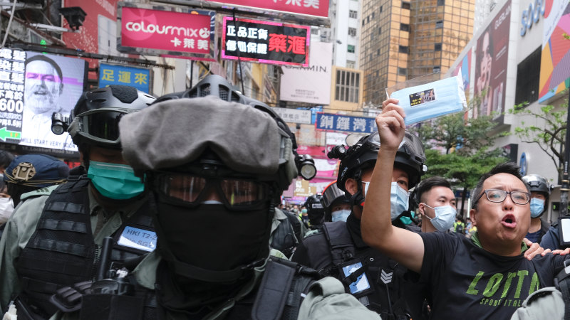 Hong Kong police fire tear gas as protests escalate - Sydney Morning Herald