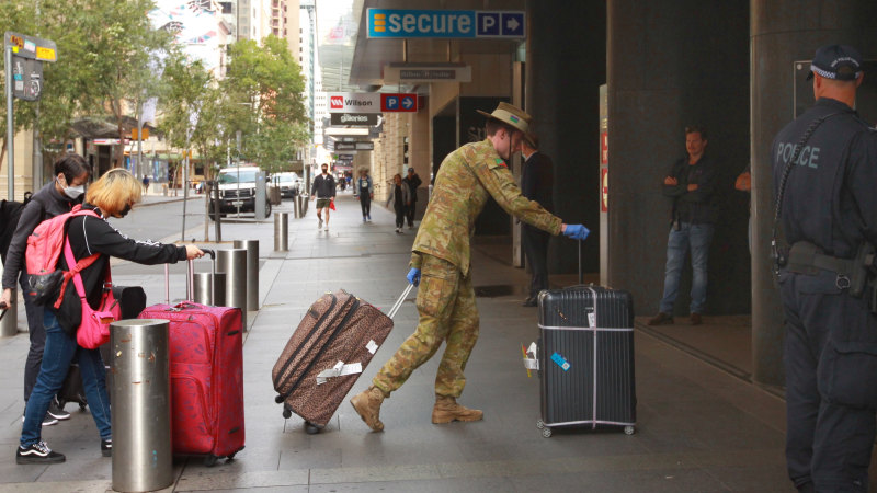 'No chance of fresh air': Sydney airport arrivals escorted to hotels - Sydney Morning Herald
