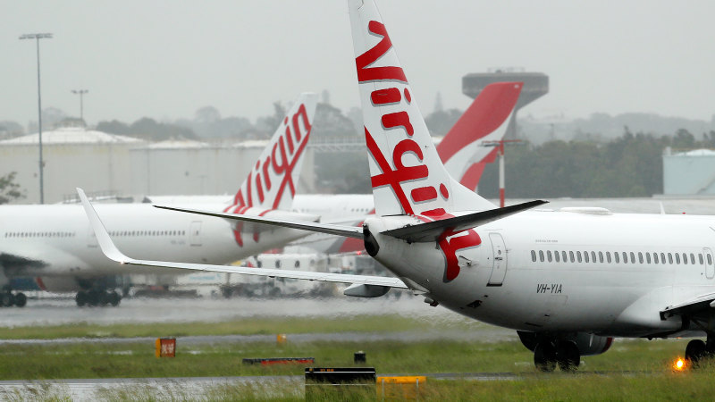 Virgin Australia cancels international flights from end of March, cuts domestic capacity - Sydney Morning Herald