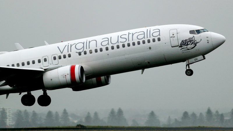 Virgin Australia cuts more flights, cancels routes amid COVID-19 - Sydney Morning Herald
