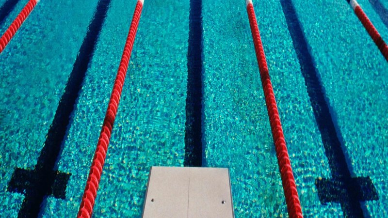 Brisbane pool closed for the day after patron tests positive for COVID-19 - Sydney Morning Herald