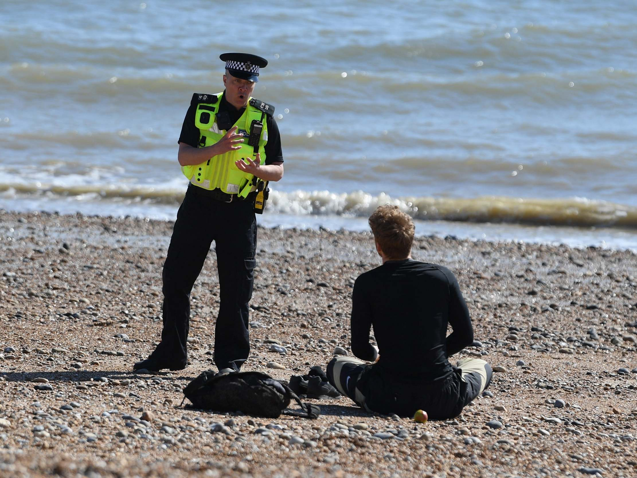 People seen flouting coronavirus lockdown by sunbathing and going for picnics, prompting police warning - The Independent