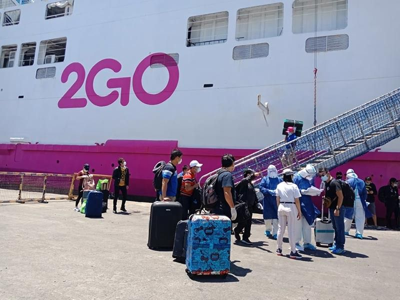 76 OFWs from Davao arrive in Oro port - Sun.Star