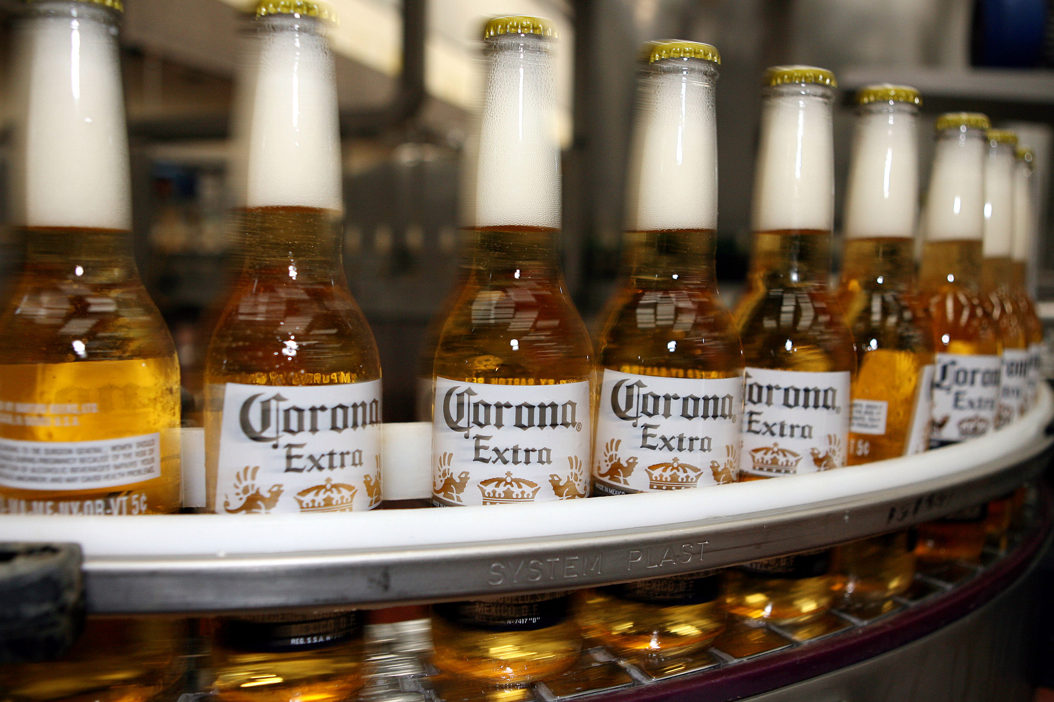 Corona brewer loses $170MILLION caused by drop in sales since outbreak of deadly coronavirus in China - The Sun